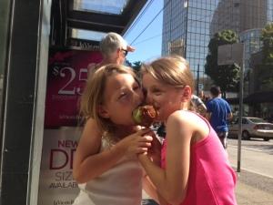 Sharing a caramel apple